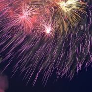 Fireworks illuminate the night sky above