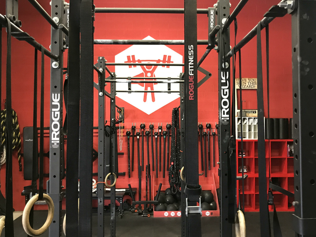 Some of the equipment at Nerdstrong, including the maces along the back wall, beneath the logo