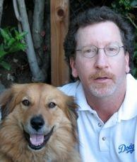 Sportswriter and Off-Ramp contributor David Davis (R), with Orly.
