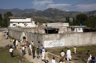 People gather outside Osama Bin Laden's compound, where he was killed during a raid by U.S. special forces, May 3, 2011 in Abottabad, Pakistan.