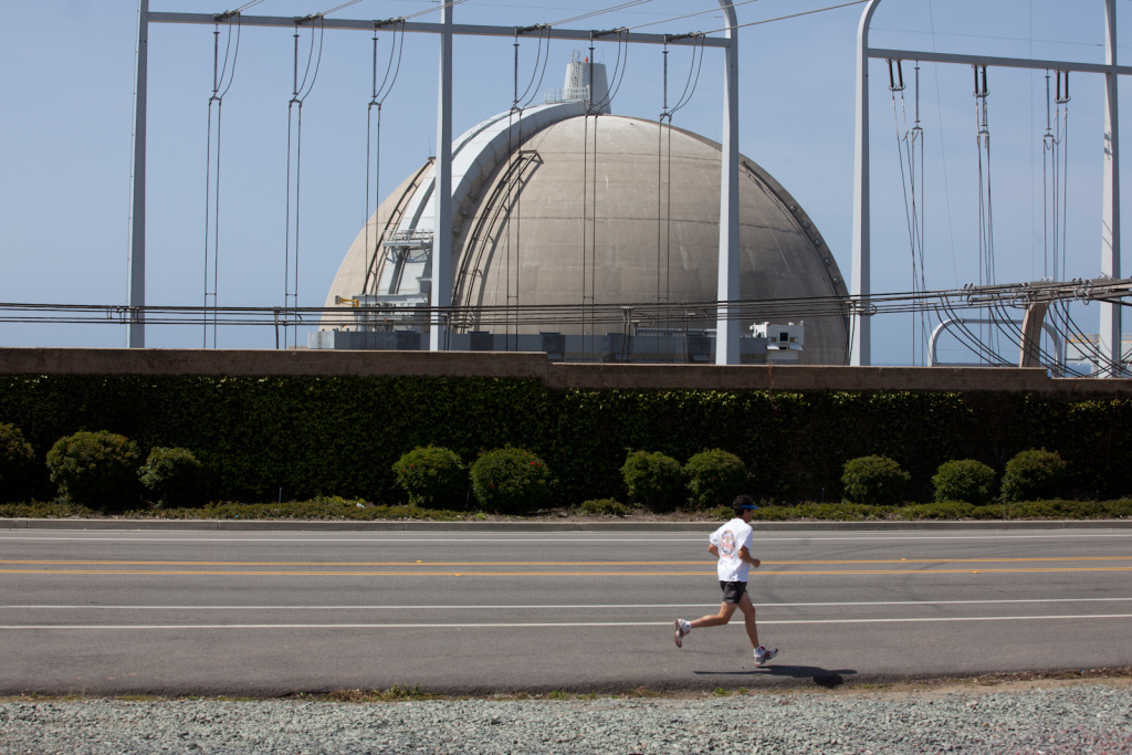 A runner passes by the San Onofre Nuclear Power Plant on April 6, 2012. Researchers at UC San Diego are working with Southern California Edison to study earthquake risks near the San Onofre nuclear plant.