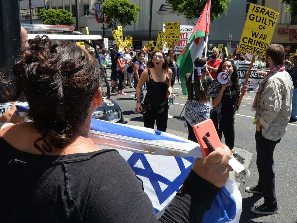 File: Palestinian-Americans and their supporters shout at a supporter of Israel during a protest march on Aug. 16, 2014 in Los Angeles.