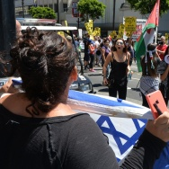 Palestinian Americans and their supporters shout at a supporter of Israel during a protest march on August 16, 2014 in Los Angeles.