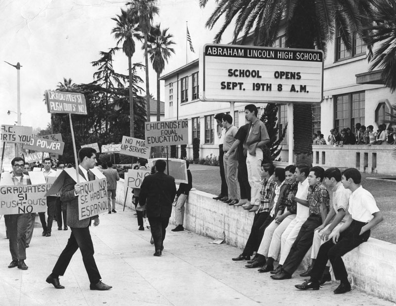 Nearly two full years before the walkouts, eighteen demonstrators picketed in front of Lincoln High School in 1966 to protest against the lack of counseling services and educational opportunities for Latino students.