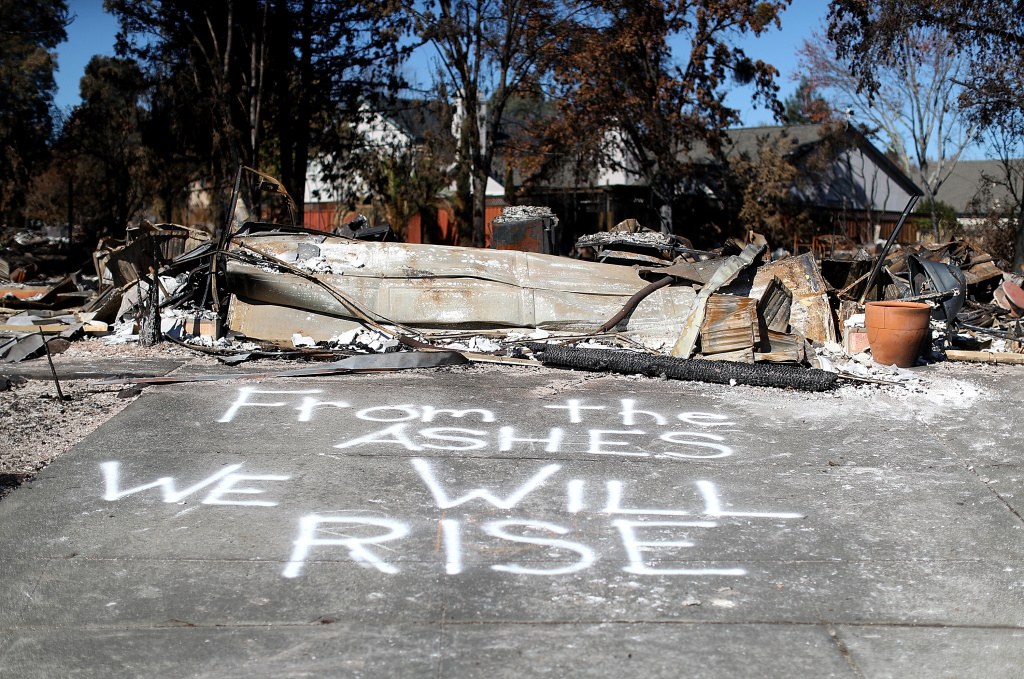 SANTA ROSA, CA - OCTOBER 23:  A message is written on driveway of a Coffey Park home that was destroyed by the Tubbs Fire on October 23, 2017 in Santa Rosa, California. Residents are returning to their homes after a fast moving and deadly widlfire destroyed 8,400 structures and claimed the lives of at least 42 people.  (Photo by Justin Sullivan/Getty Images)