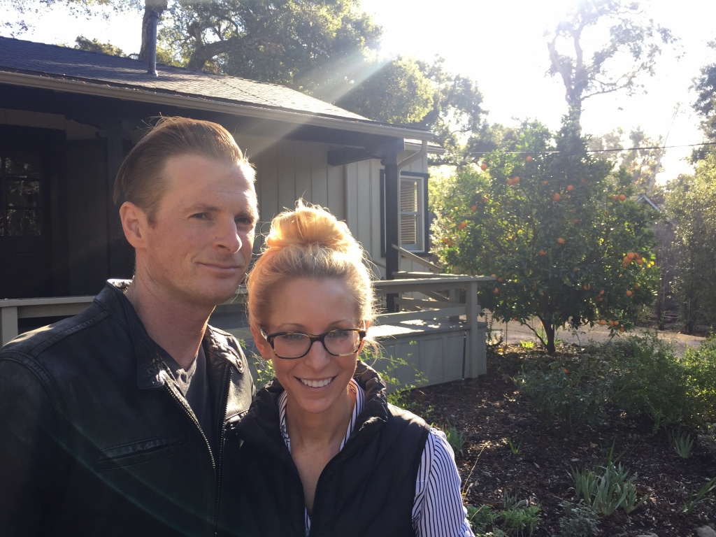 Geoff Gray and his partner Dina Landi stand outside their home, which survived the Montecito mudslides.