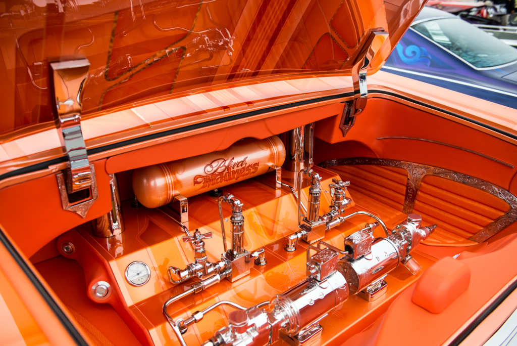 The trunk of Jesse Saldana's 1965 Chevrolet Impala Super Sport is home to the hydraulic pumps that make its chassis move up and down.