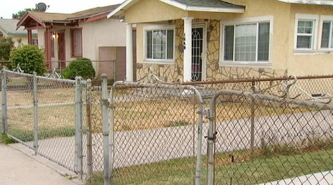 The South L.A. home where 79-year-old Cleo Hughes, the mother of an LAPD officer, was found shot to death on Sunday, June 3, 2012.
