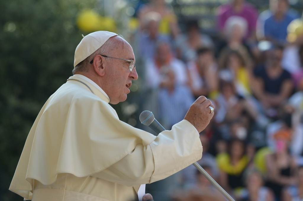 File: Pope Francis Francis delivers a speech in Isernia, southern Italy, on July 5, 2014 as part of a one day visit in the Molise region. Francis said Thursday there are limits to freedom of expression, especially when it insults or ridicules someone's faith.