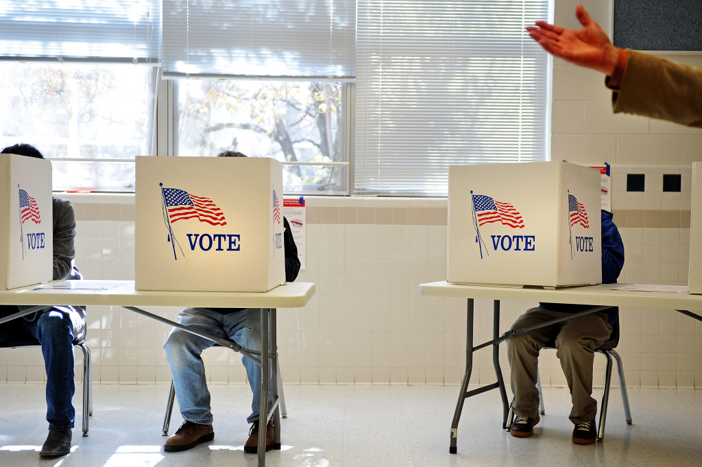 People cast their votes inside Woodson High School in the U.S. presidential race in Fairfax, Virginia.