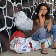 A young girl waits for her family in Honduras July 2, 2014, after being deported from the US. Some Republican lawmakers want to change immigration law to make it as easy to deport children from Central America as those from contiguous countries.