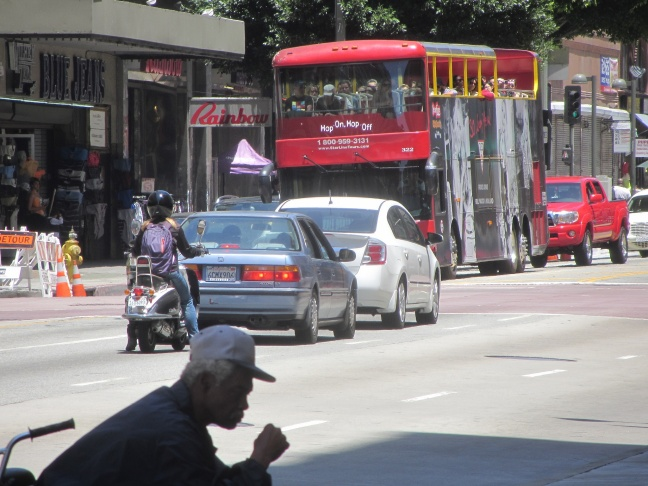 A double-decker Starline Tours bus makes a stop in downtown Los Angeles.