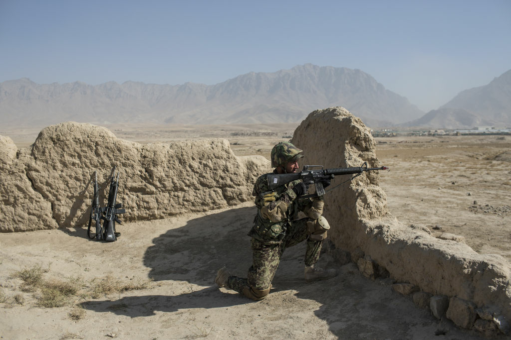 An Afghan National Army cadet secures the perimeter during a Taliban capture military exercise, overseen by French and Canadian soldiers, at the Kabul Military Training Center (KMTC) on November 13, 2012 in Kabul, Afghanistan.