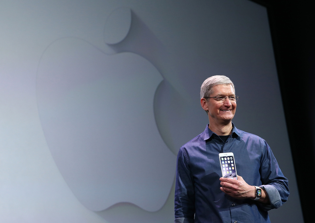 File: Apple CEO Tim Cook shows off the iPhone 6 and the Apple Watch during an Apple special event at the Flint Center for the Performing Arts on Sept. 9, 2014 in Cupertino.