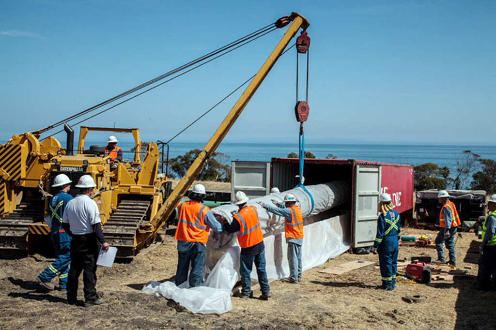 In this May 28, 2015, photo from the County of Santa Barbara, workers place a damaged section of pipe in a truck-trailer for delivery to a third-party FEMSA-approved analytical facility in Ohio, after if ruptured, spilling thousands of gallons of crude oil into the Pacific Ocean on May 19, polluting beaches and killing hundreds of birds and marine mammals north of Goleta, Calif. An engineer says photos of the pipeline that spilled oil on the Santa Barbara coast show extensive corrosion and provide clues about the rupture's cause.  (Bruce Reitherman/County of Santa Barbara via AP)