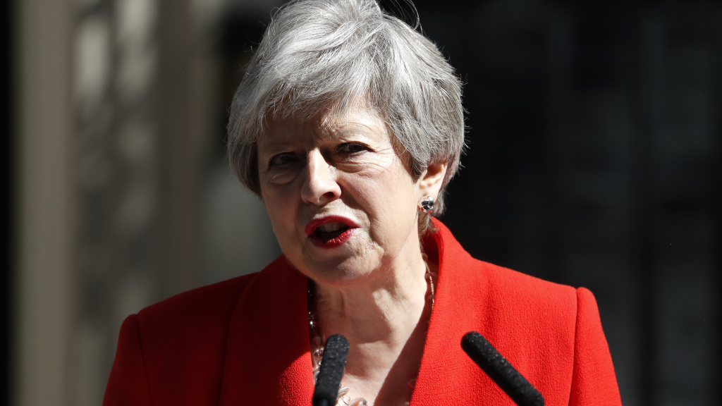 British Prime Minister Theresa May announces her resignation Friday at 10 Downing Street in London.