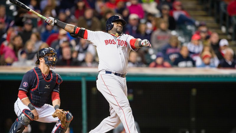 David Ortiz of the Boston Red Sox hits a two-run home run during the fourth inning against the Cleveland Indians at Progressive Field on Oct. 2, 2015. in Cleveland.