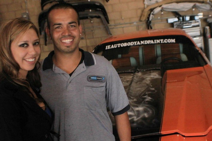 "Lucy and Isaac Gallardo in their Riverside auto body shop alongside the prize winning 1971 Camaro their crew restored on the Speed Network reality show ""Car Warriors."""
