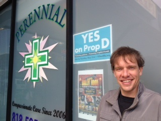 Reed Moran smells a variety of marijuana shown to him by President and CEO Sam Humeid (L) of the Perennial Holistic Wellness Center medical marijuana dispensary, which opened in 2006, on July 25, 2012 in Los Angeles.
