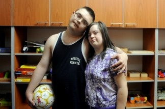 Aksentije, 14, a Serbian youth with Down Syndrome embracing his best friend Dusica (R); Aksentije plays a leading role in a film highlighting the difficulties of disabled persons being accepted into society.