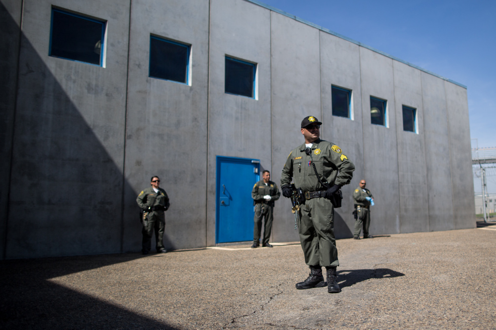 Guards prepare to search inmates in the prison's general population before they come out on the prison yard. General population inmates spend many hours a day outside or in common indoor spaces.