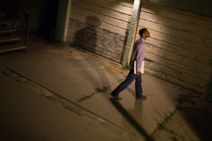 Social worker Alfred McCloud knocks on the front door of a home in south L.A. to check on a toddler. McCloud works the night shift with the Department of Child and Family Services' Emergency Response Team.