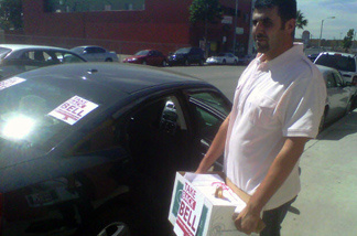 Bell resident Ali Saleh helps deliver signed petitions for a proposed recall of Bell city officials to city hall.