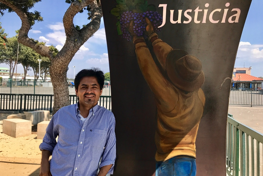 """Artist Emigdio """"Higgy"""" Vasquez's images of farmworkers adorn the inside of the portal leading to the agricultural workers memorial at the OC fairgrounds, Aug. 31, 2017."""