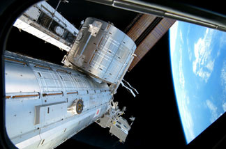 In this handout image provided by NASA, backdropped by the blackness of space and Earth's horizon, the Japanese Kibo complex of the International Space Station is seen while space shuttle Discovery remains docked with the station February 26, 2011 in space.