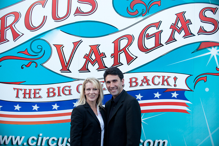 Katya Quiroga, left, and her husband, Nelson Quiroga, stand in front of a sign advertising the 46-year-old circus company they own and operate together. Circus Vargas opens its 2017 season this week in Del Mar and will arrive in Los Angeles in mid-May.