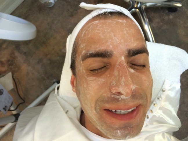 A Martinez getting a facial at FaceHaus while conducting an interview.