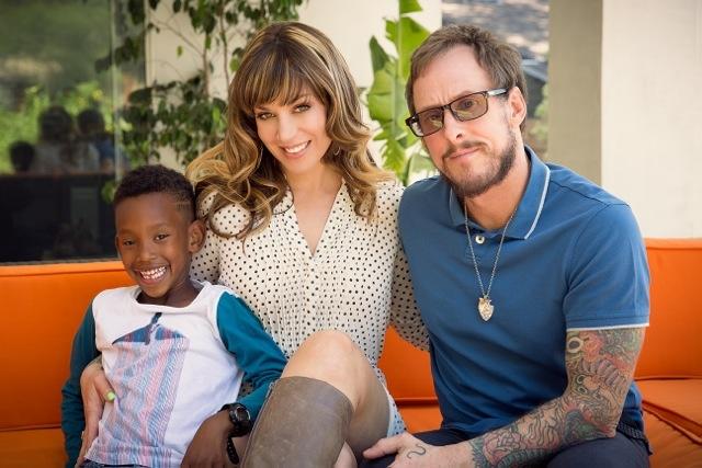 Author/wife Jillian Lauren (middle), Weezer's bassist Scott Shriner (right) and their son Tariku (left)