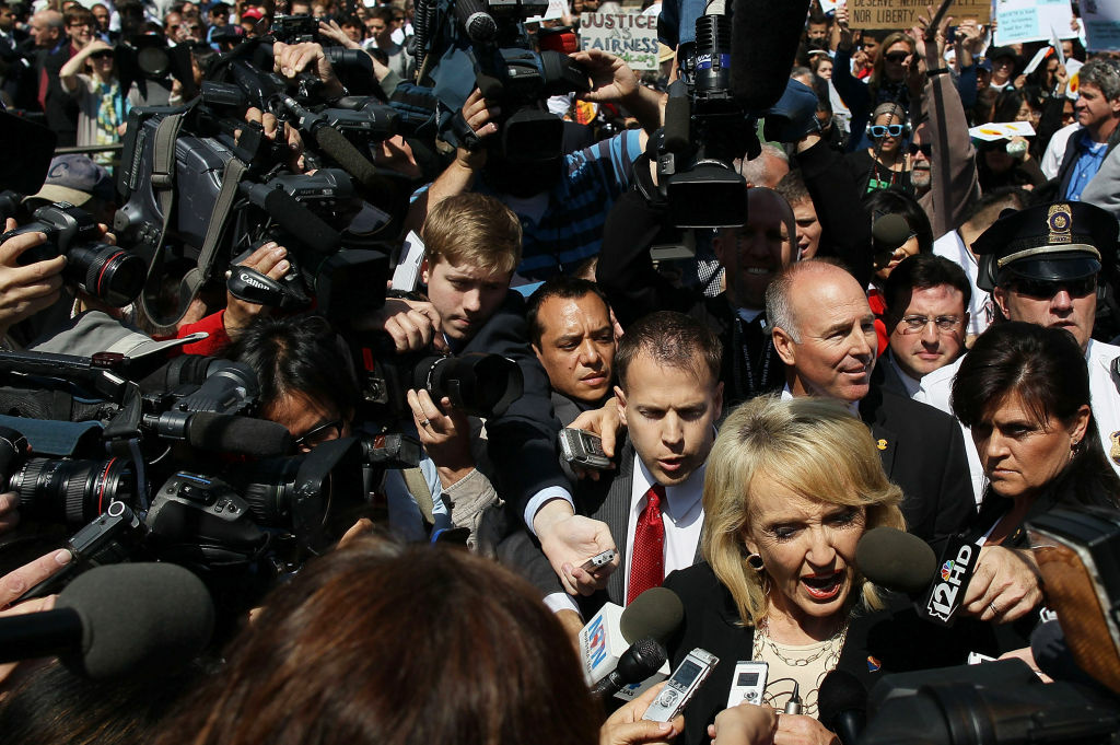 Arizona Gov. Jan Brewer speaks to the media after arguments at the U.S. Supreme Court, on April 25, 2012 in Washington, DC. Brewer strongly supported SB 1070, parts of which were struck down by the Court today.