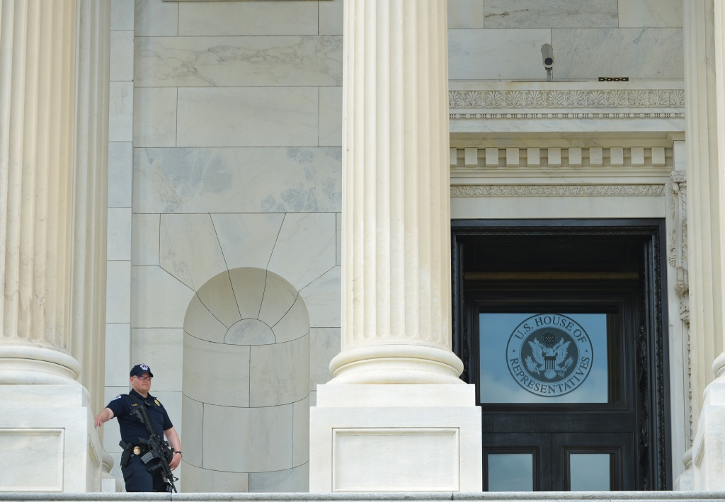 A Capitol Hill Police officer is seen on the steps of the US Capitol on April 17, 2013 in Washington, DC after the Hart Senate Office Building nearby was closed. US Capitol Police are investigating several suspicious packages that were delivered to the Hart and Russell Senate Office buildings.