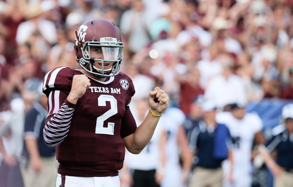 Johnny Manziel #2 of the Texas A&M Aggies celebrates a fourth quarter touchdown during the game against the Rice Owls at Kyle Field on August 31, 2013 in College Station, Texas.