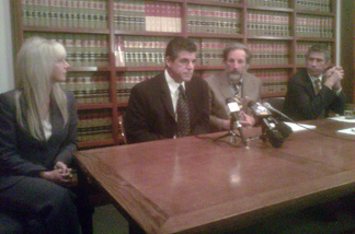 Maywood's former Building and Planning Director David Mango (center) appeared at a news conference in Pasadena yesterday with his wife and attorneys. Mango says he was wrongfully terminated after he made allegations to the FBI that city councilmembers were misusing pubic funds. Mango has filed a civil rights lawsuit against the city.