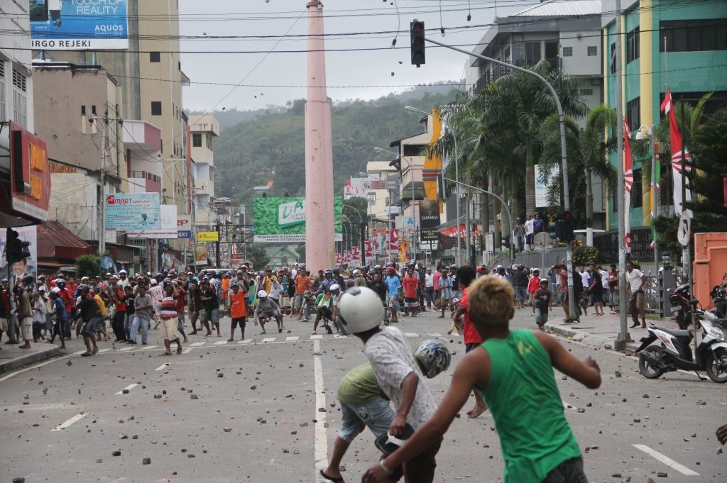 Muslims (in the foreground) face a group of Christians during a bloody clash in Ambon, the provincial capital of Indonesia's Maluku Island, on Sept. 11, 2011.