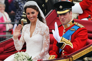 Their Royal Highnesses Prince William, Duke of Cambridge and Catherine, Duchess of Cambridge journey by carriage procession to Buckingham Palace following their marriage at Westminster Abbey on April 29, 2011 in London, England.