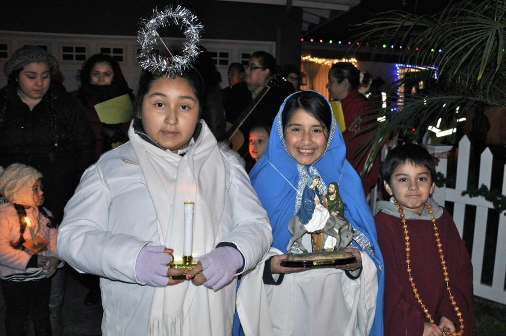 Alyssa Chavez, 9, center, and two friends prepare to lead a neighborhood Las Posadas procession in Santa Ana last Friday night, Dec. 21, 2012