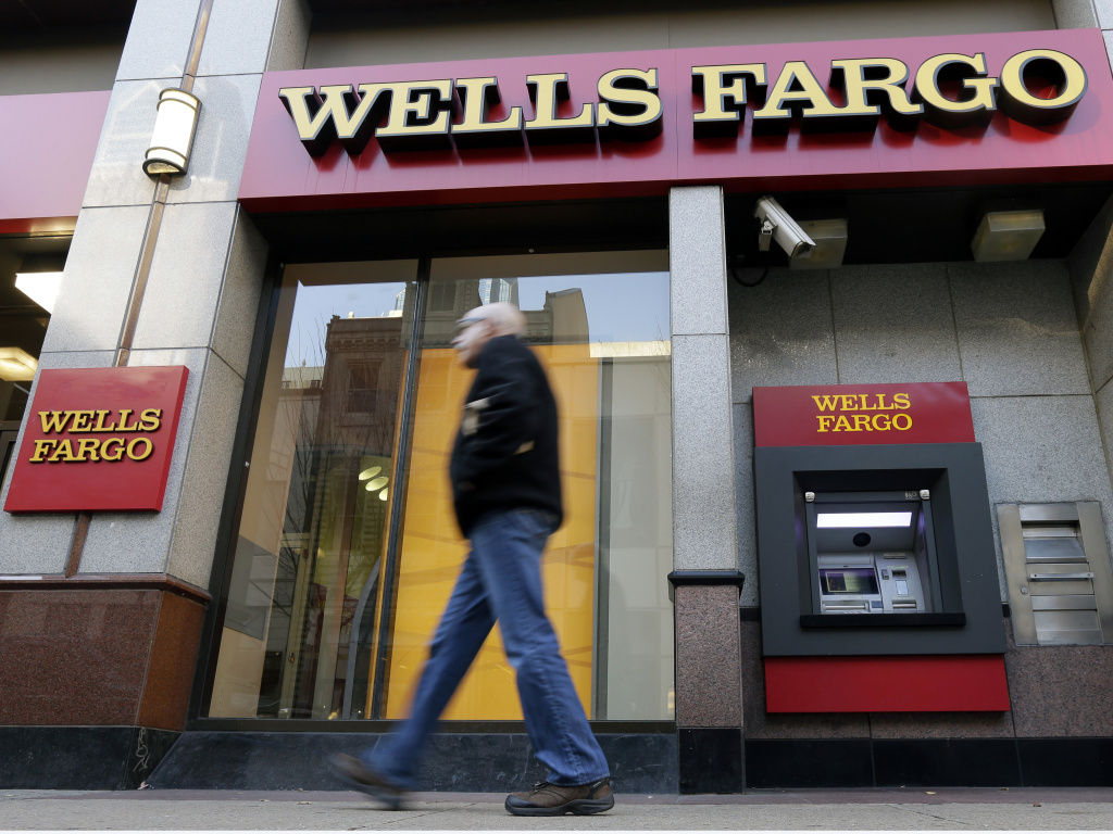 File: A man walks past a Wells Fargo branch in Philadelphia.