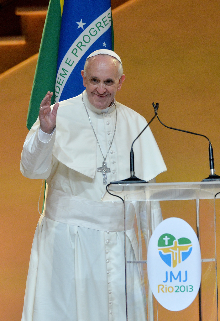 Pope Francis greets the audience during the welcoming ceremony at the Guanabara Palace, seat of the city's government, in Rio de Janeiro, on July 22, 2013.