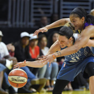Los Angeles Sparks forward Candace Parker, right, reaches in on Minnesota Lynx guard Anna Cruz during the second half in Game 4 of the WNBA Finals, Sunday, Oct. 16, 2016, in Los Angeles. The Lynx won 85-79. (AP Photo/Mark J. Terrill)