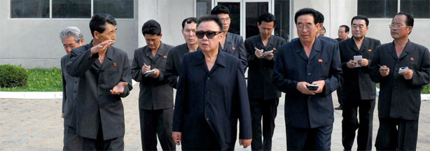 This undated picture, released from Korean Central News Agency on June 19, 2010, shows North Korean leader Kim Jong Il (in sunglasses) inspecting a factory.