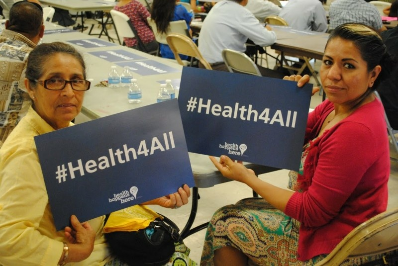 Fresno residents demonstrate their support for a county health program that covers care for undocumented immigrant