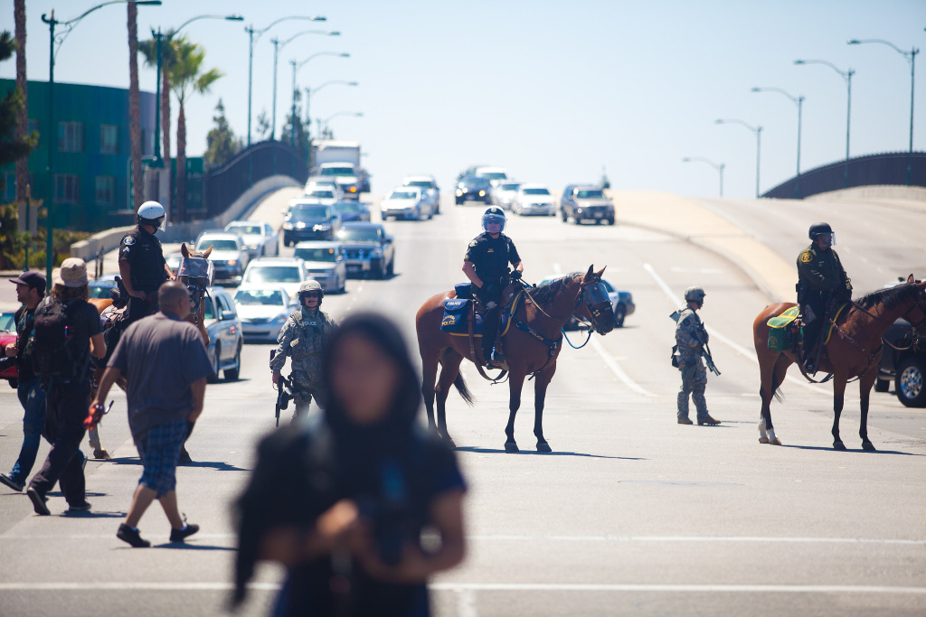 A line of Orange County Police Officers block a freeway overpass leading to Disneyland during a protests to show outrage for the several recent officer involved shootings on July 29, 2012 in Anaheim, California. For the past week, protesters have clashed with police resulting in both property damage and many arrests.