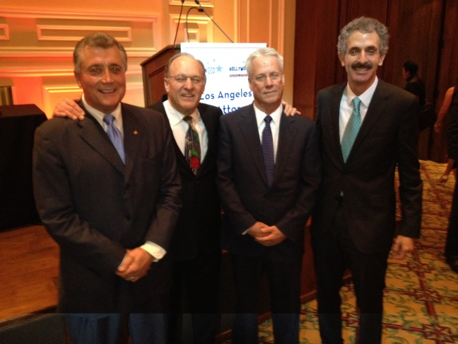 From left to right, incumbent City Attorney Carmen Trutanich, attorney Noel Weiss, attorney Greg Smith and former State Assemblyman Mike Feuer pose for a photo after their debate Thursday (01/17/13) at the Taglyan Complex in Hollywood.
