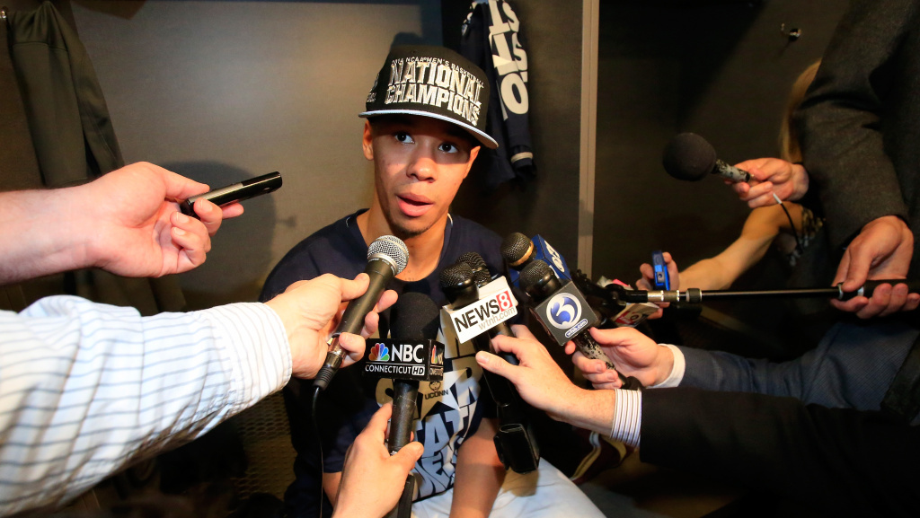 Shabazz Napier of the Connecticut Huskies speaks to the media in the locker room after defeating Kentucky in the NCAA Men's Final Four Championship on April 7.