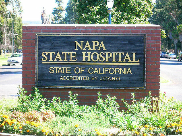 Photo of the Napa State Hospital's main sign. Workers in the criminal patient ward will be required to wear alarm-equipped lanyards beginning Tuesday.