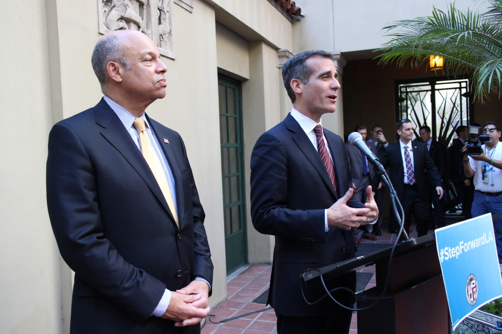 Mayor Eric Garcetti, right, and Department of Homeland Security Secretary Jeh Johnson spoke Thursday at the Los Angeles Central Library, in advance of the Feb. 18 kickoff of the Obama administration's executive immigration plan. Garcetti said the city is committing resources toward assisting immigrants who seek to apply. Librarians will be trained to provide information to those seeking temporary legal status and work permits.