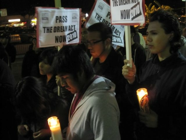 Dream Act supporters hold signs and votive candles during a rally and vigil on Dec. 7, 2010 outside La Placita Church in downtown LA near Olvera Street.
